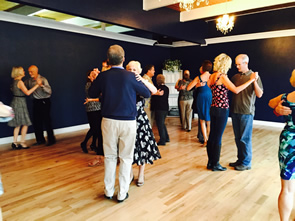 photo of a group class at Step It Up Ballroom Society